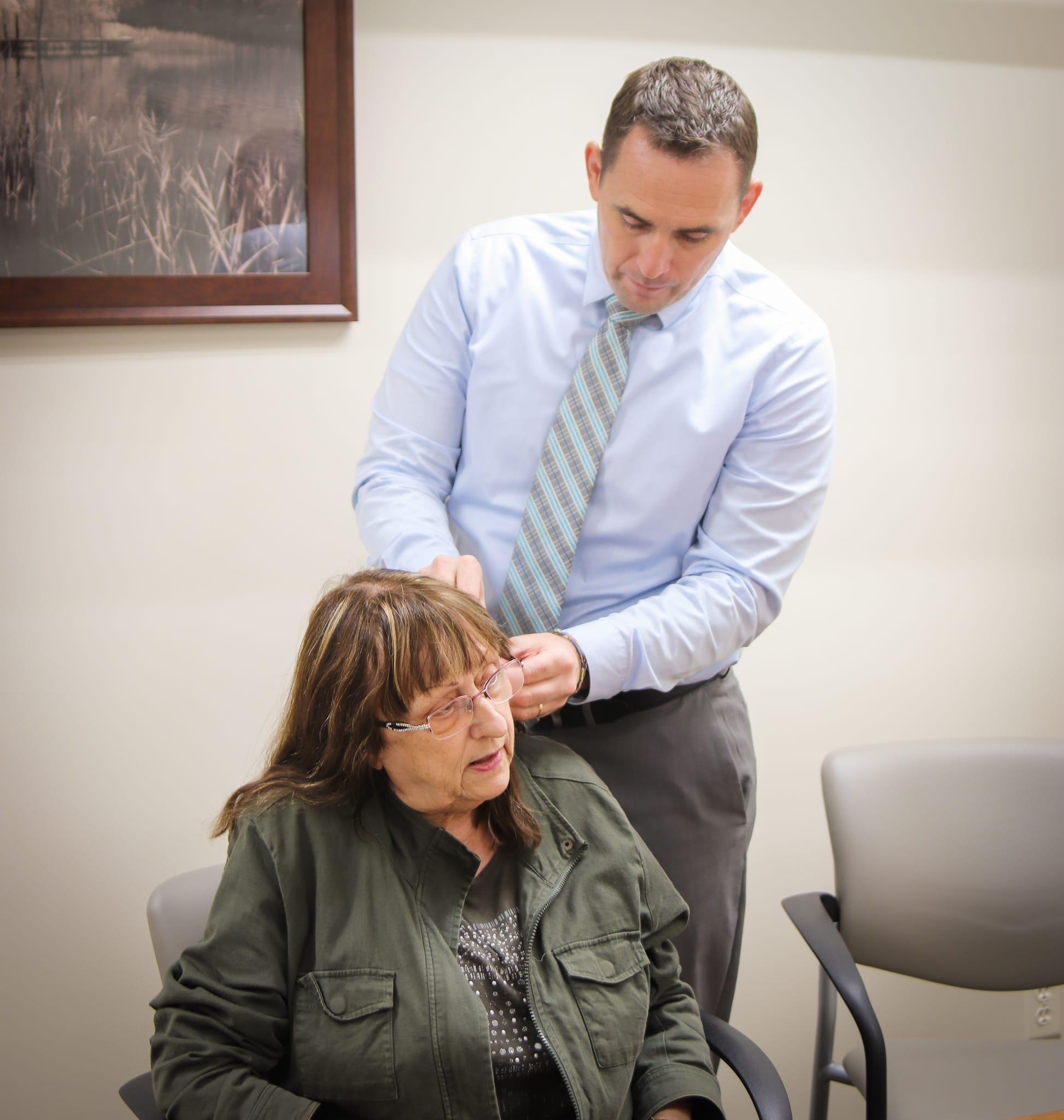 dr blake studley examining hearing aid