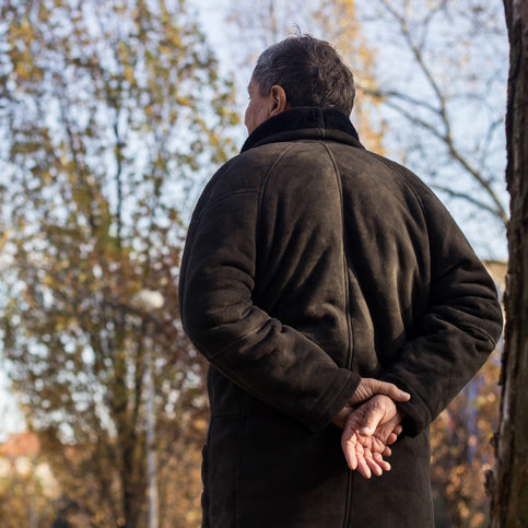 older man taking a walk outside