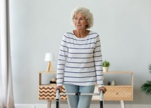 older woman with hearing device