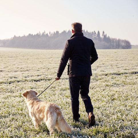 man walking his dog outside